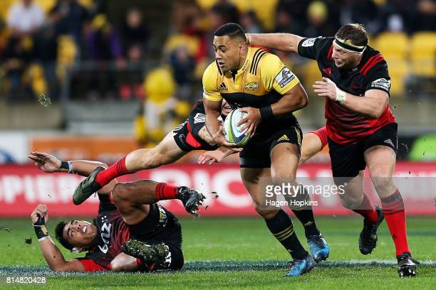 Ngani Laumape of the Hurricanes is tackled by Wyatt Crockett of the Crusaders uring the round 17 Super Rugby match between the Hurricanes and the...