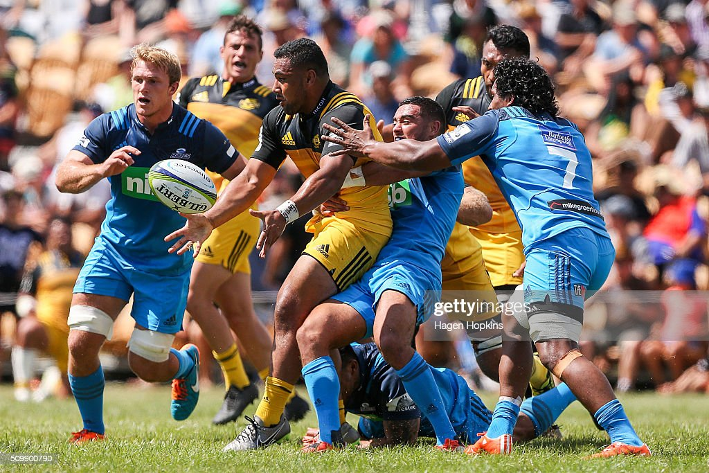 Ngani Laumape of the Hurricanes is tackled during the Super Rugby pre-season match between the Blues and the Hurricanes at Eketahuna Rugby Club on February 13, 2016 in Eketahuna, New Zealand.