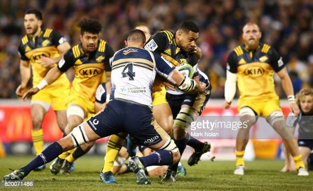 Ngani Laumape of the Hurricanes is tackled during the Super Rugby Quarter Final match between the Brumbies and the Hurricanes at Canberra Stadium on...