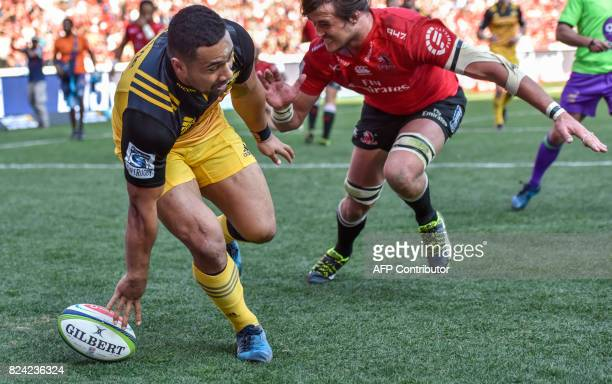 Ngani Laumape of the Hurricanes scores a try with Franco Mostert of the Lions to late to stop him during the SuperXV rugby union semifinal match...