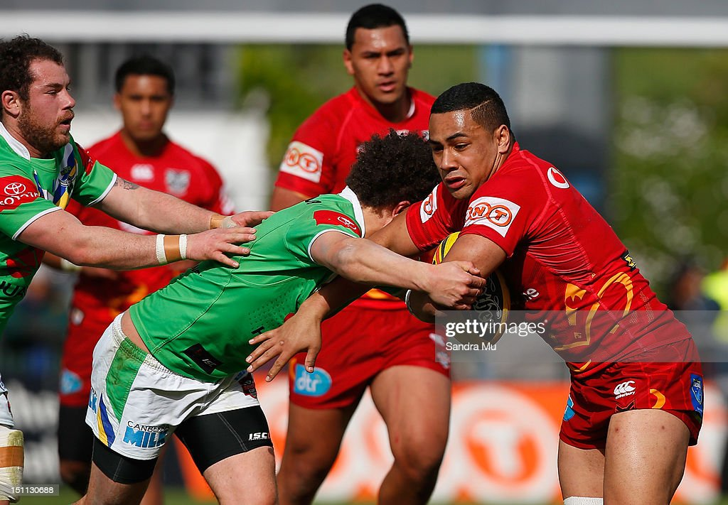 Ngani Laumape of the Junior Warriors is tackled during the Toyota Cup round 26 match between the New Zealand Warriors and the Canberra Raiders at Mt Smart Stadium on September 2, 2012 in Auckland, New Zealand.