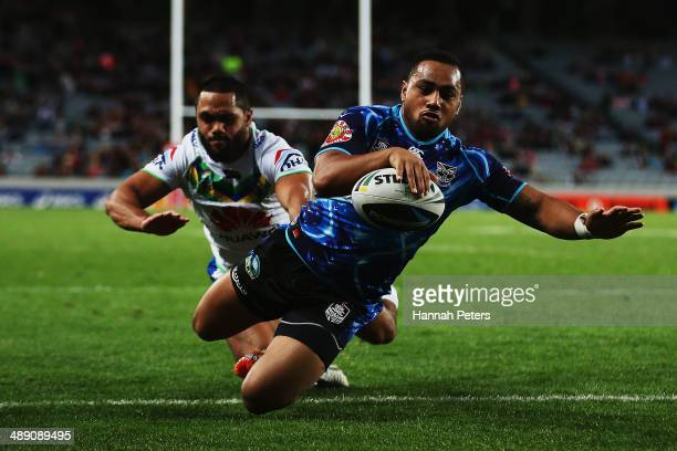 Ngani Laumape of the Warriors dives over to score a try during the round nine NRL match between the New Zealand Warriors and the Canberra Raiders at...