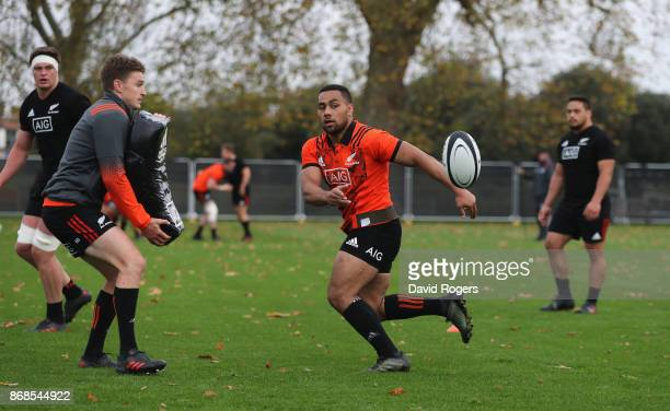 Ngani Laumape passes the ball during the New Zealand All Blacks training session held at the Lensbury on October 31 2017 in London England