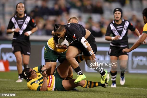 Ngatokotoru Arakua of the Kiwi Ferns is tackled during the women's ANZAC Test match between the Australian Jillaroos and the New Zealand Kiwi Ferns...