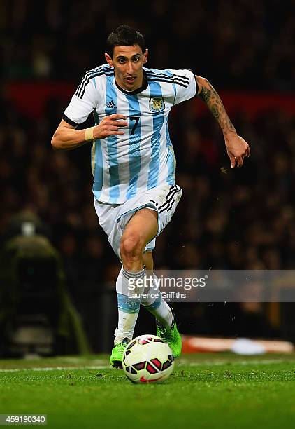 Ángel Di Maria of Argentina runs with the ball during the International Friendly between Argentina and Portugal at Old Trafford on November 18 2014...