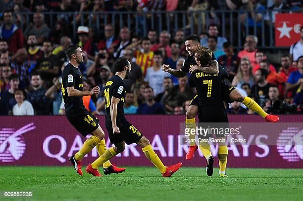 Ángel Martín Correa of FC Barcelona celebrates with team mates after scoring during the Spanish League match between FC Barcelona vs Club Atlético de...