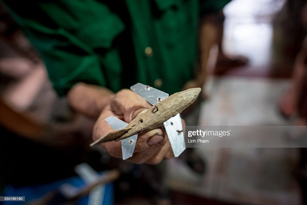 Ngo Sy Loi, 69 years-old Vietnam War veteran who is passionate about making model war aircraft and vehicles, shows one of his model stealth aircraft at his house on May 25, 2016 in Bac Ninh, near Hanoi, Vietnam. U.S. President Obama made his historic visit to Vietnam on May 23 with an aim to strengthen the strategic and economic relationship between both countries four decades after the Vietnam war. During the visit, Obama announced the U.S. will fully lift its embargo on weapons and raised issues related to human rights while speaking to the youths on freedom of expression.