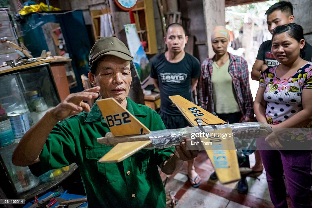 Ngo Sy Loi, 69 years-old Vietnam War veteran who is passionate about making model war aircraft and vehicles, shows his neighbors how B-52 aircraft operated at his house on May 25, 2016 in Bac Ninh, near Hanoi, Vietnam. U.S. President Obama made his historic visit to Vietnam on May 23 with an aim to strengthen the strategic and economic relationship between both countries four decades after the Vietnam war. During the visit, Obama announced the U.S. will fully lift its embargo on weapons and raised issues related to human rights while speaking to the youths on freedom of expression.