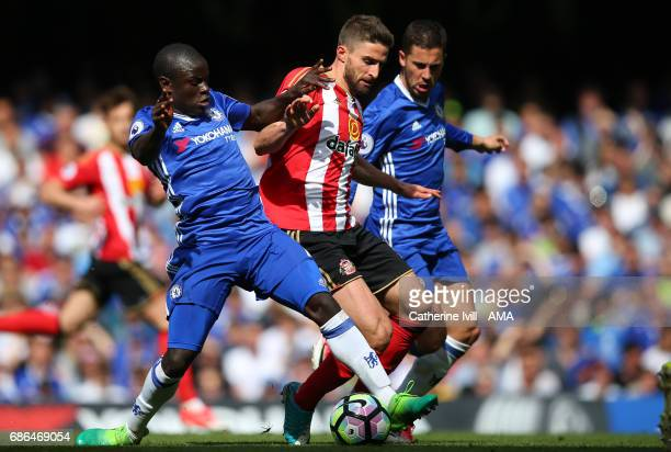 NÕgolo Kante and Eden Hazard of Chelsea compete with Fabio Borini of Sunderland during the Premier League match between Chelsea and Sunderland at...