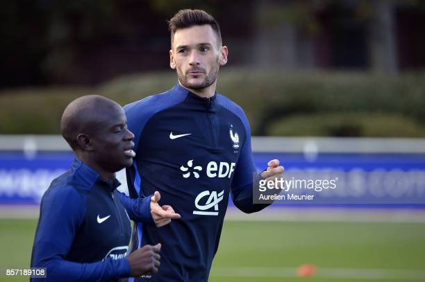 Ngolo Kante and Hugo Lloris of France warmup during a France training session on October 3 2017 in Clairefontaine France