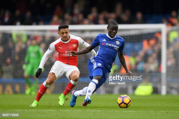 Ngolo Kante of Chelsea runs with the ball under pressure from Alexis Sanchez of Arsenal during the Premier League match between Chelsea and Arsenal...