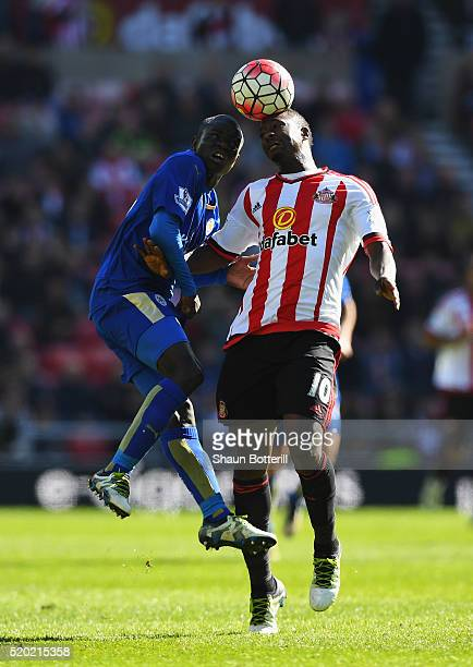 Ngolo Kante of Leicester City and Dame N'Doye of Sunderland jump for the ball during the Barclays Premier League match between Sunderland and...