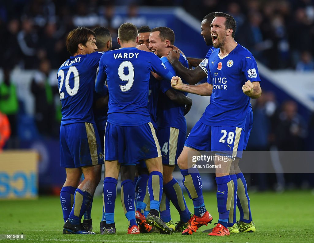Ngolo Kante of Leicester City celebrates scoring his team's first goal with his team mates during the Barclays Premier League match between Leicester...