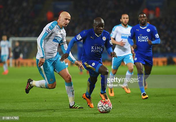 Ngolo Kante of Leicester City is chased by Jonjo Shelvey of Newcastle United during the Barclays Premier League match between Leicester City and...