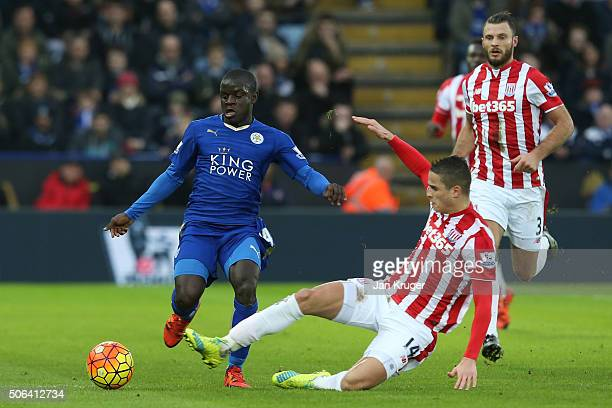 Ngolo Kante of Leicester City is tackled by Ibrahim Afellay of Stoke City during the Barclays Premier League match between Leicester City and Stoke...