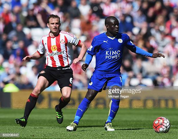 Ngolo Kante of Leicester City is watched by Lee Cattermole of Sunderland during the Barclays Premier League match between Sunderland and Leicester...