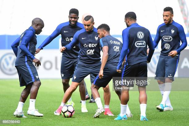 Ngolo Kante Samuel Umtiti Dimitri Payet Thomas Lemar Alexandre Lacazette and Corentin Tolisso of France during the France training session at Stade...