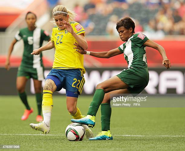 Ngozi Ebere of Nigeria is challenged by Olivia Schough of Sweden during the FIFA Women's World Cup Canada 2015 Group D match between Sweden and...