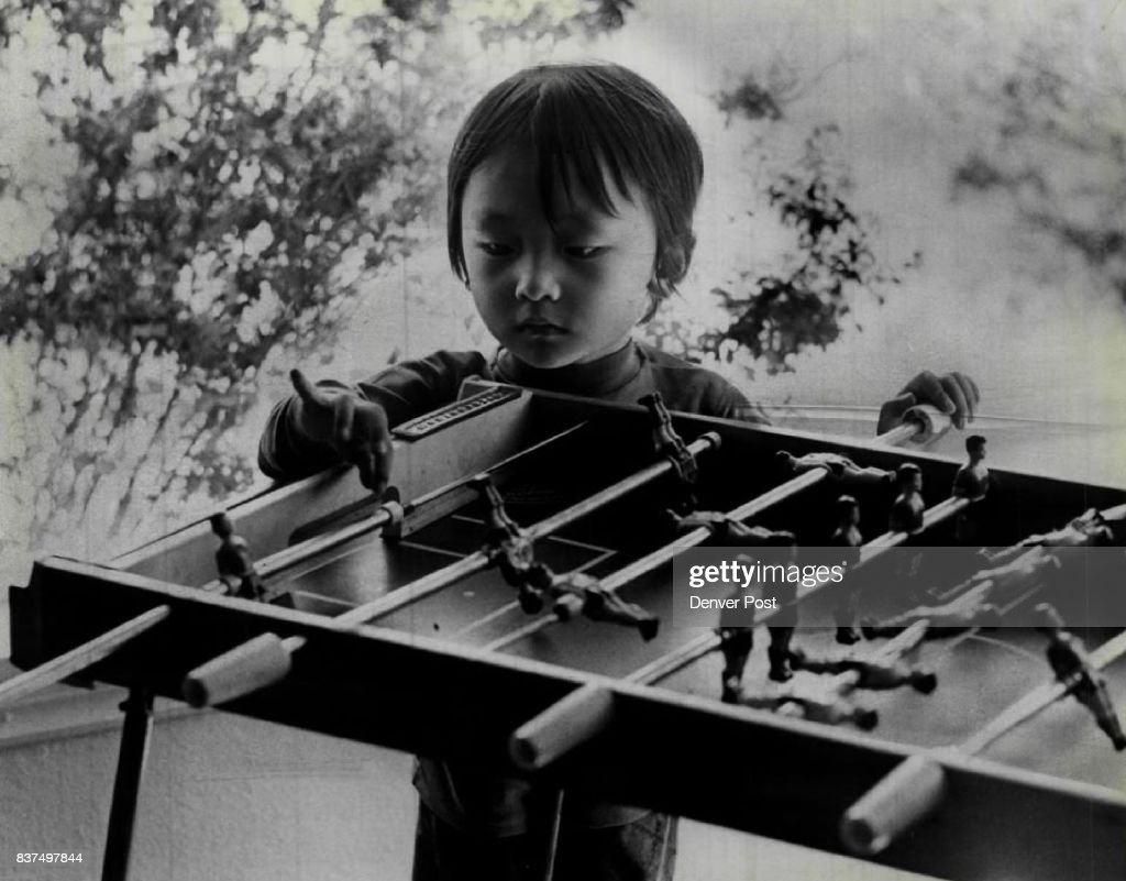 Nguyen Bao Long, 3, Examines Foosball Table The Table, A Favorite Of The