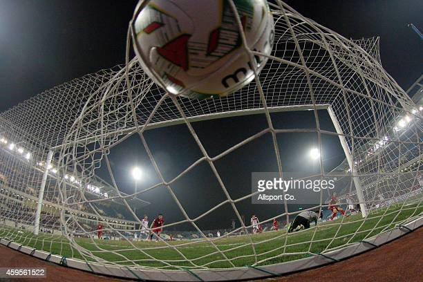 Nguyen Huy Hung of Vietnam scores against Laos during the 2014 AFF Suzuki Cup Group A match between Laos and Vietnam at the My Dinh Stadium on...