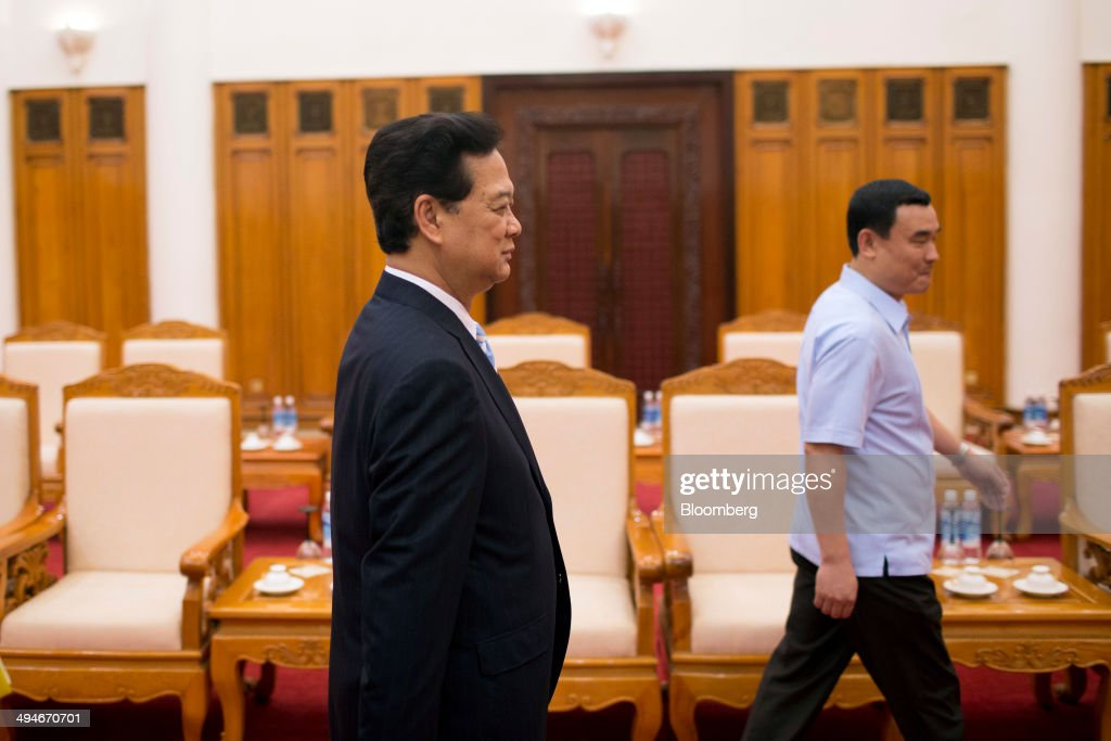 <a gi-track='captionPersonalityLinkClicked' href=/galleries/search?phrase=Nguyen+Tan+Dung&family=editorial&specificpeople=544511 ng-click='$event.stopPropagation()'>Nguyen Tan Dung</a>, Vietnam's prime minister, enters a room before an interview in Hanoi, Vietnam, on Friday, May 30, 2014. Vietnam has prepared evidence for a legal suit challenging Chinas claim to waters off the Vietnamese coast and is considering the best time to file it, Prime Minister <a gi-track='captionPersonalityLinkClicked' href=/galleries/search?phrase=Nguyen+Tan+Dung&family=editorial&specificpeople=544511 ng-click='$event.stopPropagation()'>Nguyen Tan Dung</a> said today in an interview. Photographer: Brent Lewin/Bloomberg via Getty Images