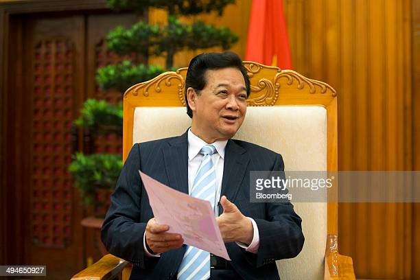 Nguyen Tan Dung Vietnam's prime minister holds a map of Vietnam during an interview in Hanoi Vietnam on Friday May 30 2014 Vietnam has prepared...
