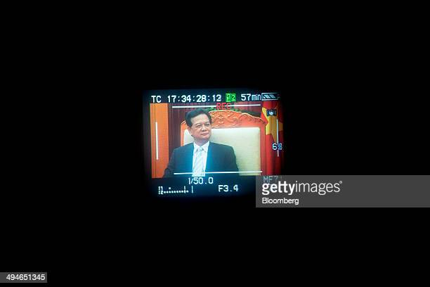Nguyen Tan Dung Vietnam's prime minister is seen on a camera viewfinder during an interview in Hanoi Vietnam on Friday May 30 2014 Vietnam has...