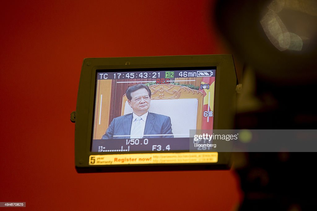 <a gi-track='captionPersonalityLinkClicked' href=/galleries/search?phrase=Nguyen+Tan+Dung&family=editorial&specificpeople=544511 ng-click='$event.stopPropagation()'>Nguyen Tan Dung</a>, Vietnam's prime minister, is seen on a camera viewfinder during an interview in Hanoi, Vietnam, on Friday, May 30, 2014. Vietnam has prepared evidence for a legal suit challenging Chinas claim to waters off the Vietnamese coast and is considering the best time to file it, Prime Minister <a gi-track='captionPersonalityLinkClicked' href=/galleries/search?phrase=Nguyen+Tan+Dung&family=editorial&specificpeople=544511 ng-click='$event.stopPropagation()'>Nguyen Tan Dung</a> said today in an interview. Photographer: Brent Lewin/Bloomberg via Getty Images