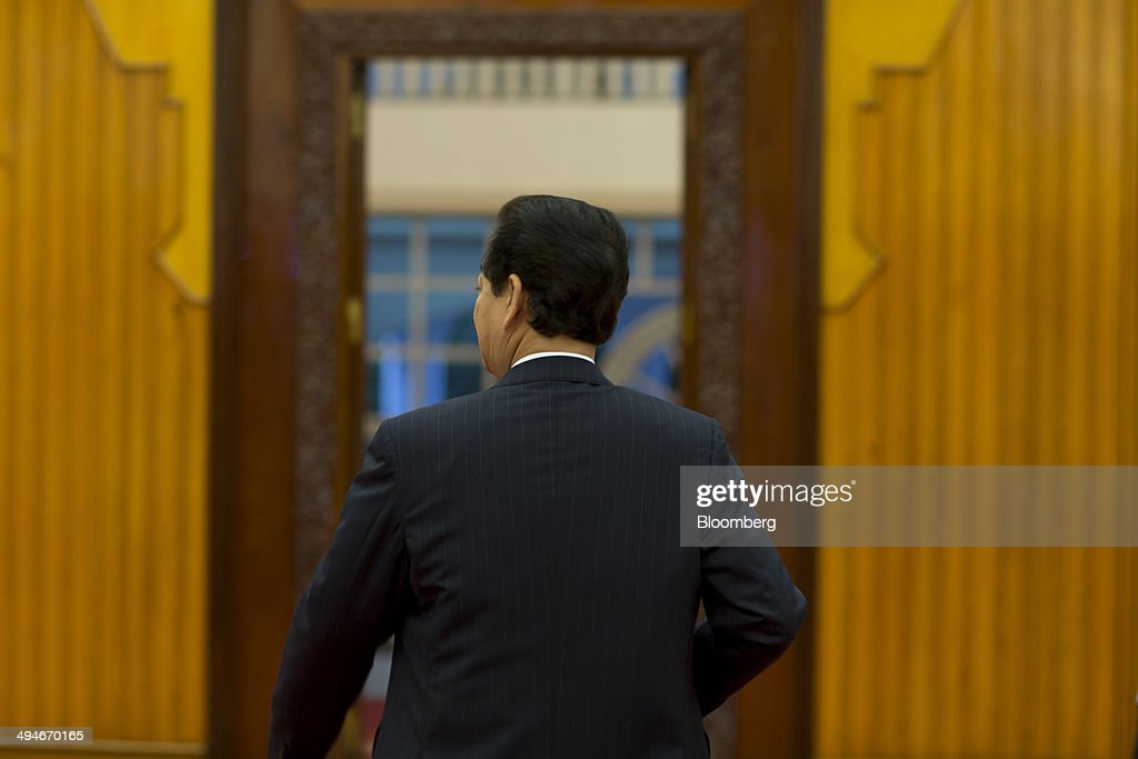 <a gi-track='captionPersonalityLinkClicked' href=/galleries/search?phrase=Nguyen+Tan+Dung&family=editorial&specificpeople=544511 ng-click='$event.stopPropagation()'>Nguyen Tan Dung</a>, Vietnam's prime minister, leaves the room after an interview in Hanoi, Vietnam, on Friday, May 30, 2014. Vietnam has preparwtlked evidence for a legal suit challenging Chinas claim to waters off the Vietnamese coast and is considering the best time to file it, Prime Minister <a gi-track='captionPersonalityLinkClicked' href=/galleries/search?phrase=Nguyen+Tan+Dung&family=editorial&specificpeople=544511 ng-click='$event.stopPropagation()'>Nguyen Tan Dung</a> said today in an interview. Photographer: Brent Lewin/Bloomberg via Getty Images