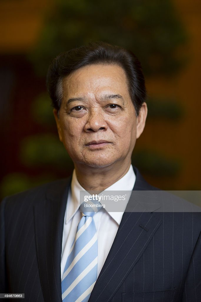 <a gi-track='captionPersonalityLinkClicked' href=/galleries/search?phrase=Nguyen+Tan+Dung&family=editorial&specificpeople=544511 ng-click='$event.stopPropagation()'>Nguyen Tan Dung</a>, Vietnam's prime minister, poses for a photograph after an interview in Hanoi, Vietnam, on Friday, May 30, 2014. Vietnam has prepared evidence for a legal suit challenging Chinas claim to waters off the Vietnamese coast and is considering the best time to file it, Prime Minister <a gi-track='captionPersonalityLinkClicked' href=/galleries/search?phrase=Nguyen+Tan+Dung&family=editorial&specificpeople=544511 ng-click='$event.stopPropagation()'>Nguyen Tan Dung</a> said today in an interview. Photographer: Brent Lewin/Bloomberg via Getty Images