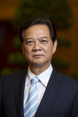 Nguyen Tan Dung Vietnam's prime minister poses for a photograph after an interview in Hanoi Vietnam on Friday May 30 2014 Vietnam has prepared...