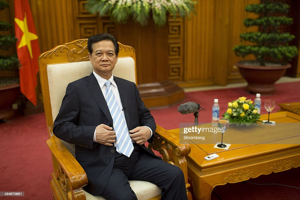 <a gi-track='captionPersonalityLinkClicked' href=/galleries/search?phrase=Nguyen+Tan+Dung&family=editorial&specificpeople=544511 ng-click='$event.stopPropagation()'>Nguyen Tan Dung</a>, Vietnam's prime minister, sits in a chair before an interview in Hanoi, Vietnam, on Friday, May 30, 2014. Vietnam has prepared evidence for a legal suit challenging Chinas claim to waters off the Vietnamese coast and is considering the best time to file it, Prime Minister <a gi-track='captionPersonalityLinkClicked' href=/galleries/search?phrase=Nguyen+Tan+Dung&family=editorial&specificpeople=544511 ng-click='$event.stopPropagation()'>Nguyen Tan Dung</a> said today in an interview. Photographer: Brent Lewin/Bloomberg via Getty Images