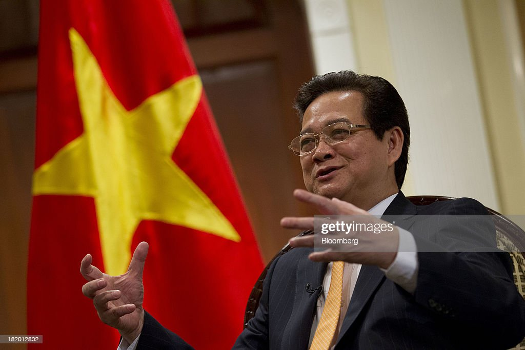 <a gi-track='captionPersonalityLinkClicked' href=/galleries/search?phrase=Nguyen+Tan+Dung&family=editorial&specificpeople=544511 ng-click='$event.stopPropagation()'>Nguyen Tan Dung</a>, Vietnam's prime minister, speaks during an interview in New York, U.S., on Friday, Sept. 27, 2013. Vietnams economic growth quickened this quarter as rising foreign investment helped support manufacturing and exports, countering weak lending from a banking industry burdened by bad debt. Photographer: Jin Lee/Bloomberg via Getty Images