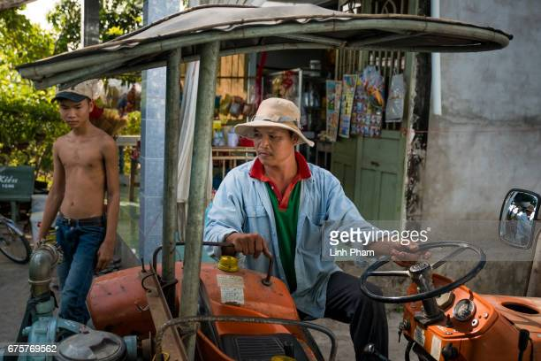 Nguyen Thanh Nhat a water truck driver pumps fresh water from his truck to client's storages on April 28 2017 in Thua Duc Village Binh Dai District...