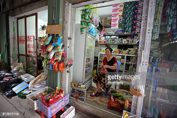 Nguyen Thi Dung sits in her grocery store in Ap Don hamlet Bac Ninh Province Vietnam on Thursday Sept 1 2016 Samsung Electronics Co and its affiliate...