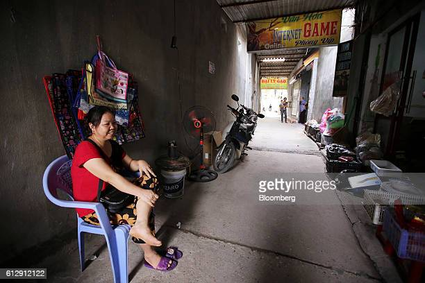 Nguyen Thi Dung sits opposite her grocery store in Ap Don hamlet Bac Ninh Province Vietnam on Thursday Sept 1 2016 Samsung Electronics Co and its...