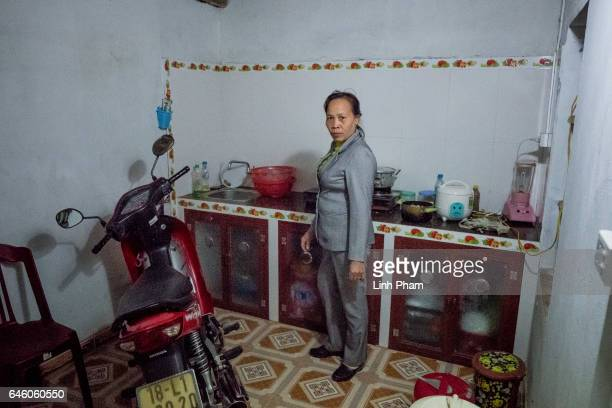 Nguyen Thi Vy stepmother of Doan Thi Huong prepares dinner at Huong's family home after the Sunday service at Phuong Lac church on February 27 2017...