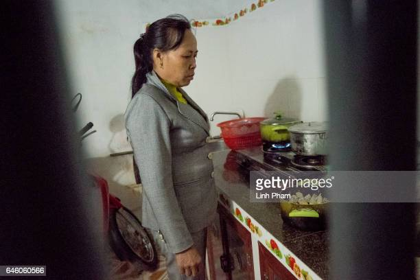 Nguyen Thi Vy stepmother of Doan Thi Huong prepares dinner for her family after the Sunday service at Phuong Lac church on February 27 2017 in Nghia...