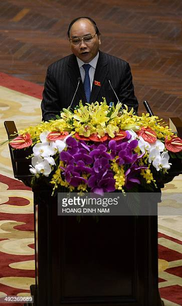 Nguyen Xuan Phuc politburo member and Deputy Prime Minister delivers the main economic and political report at the opening of the National Assembly's...