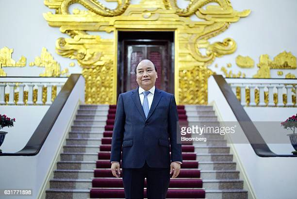 Nguyen Xuan Phuc Vietnam's prime minister stands for a photograph at the Government Office in Hanoi Vietnam on Friday Jan 13 2017 Vietnam will raise...