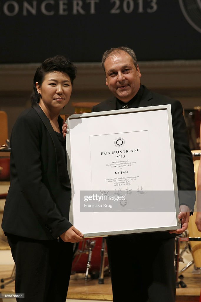 Ni Fan and Juergen Christ attend the Prix Montblanc 2013 at Konzerthaus Am Gendarmenmarkt on October 30, 2013 in Berlin, Germany.