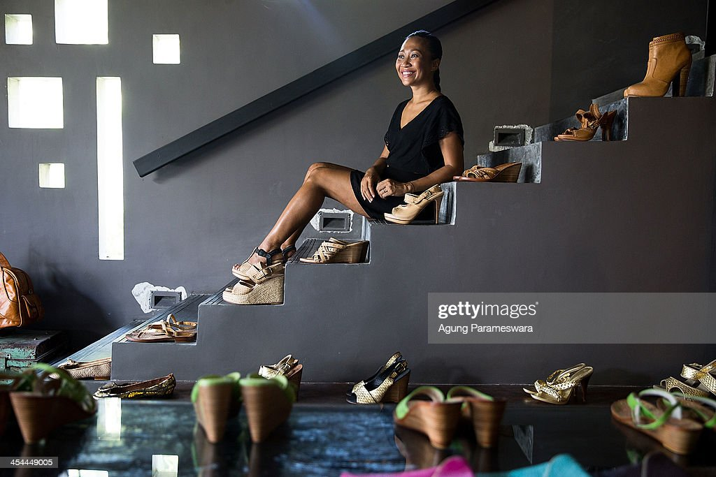Ni Luh Ayu Pertami, the designer and the owner of Niluh Djelantik poses for portrait at her store on November 12, 2013 in Seminyak, Bali, Indonesia. Niluh Djelantik (formerly called Nilou), the hand made high end leather shoe, is produced by Balinese shoe lover and designer Ni Luh Ayu Pertami with 40 shoes designers and workers in a small atelier at Canggu Village. This brand signature by a unique engraving and designed to be comfortable high heels or wedges with elegan touch. Celebrities like Cate Blanchett, Uma Thurman, Julia Roberts, Paris Hilton, Cameron Diaz and American top model Gisele Bundchen have been known to purchase Niluh Djelantik beautiful shoes and sandals.