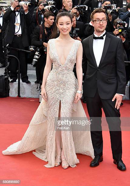 Ni Ni tand her guest attend the screening of 'Cafe Society' at the opening gala of the annual 69th Cannes Film Festival at Palais des Festivals on...