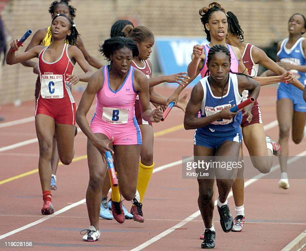 Nia Ali of Philadelphia West Catholic High drops the baton at the start of the third leg on exchange from Latavia Thomas in the Championship of...