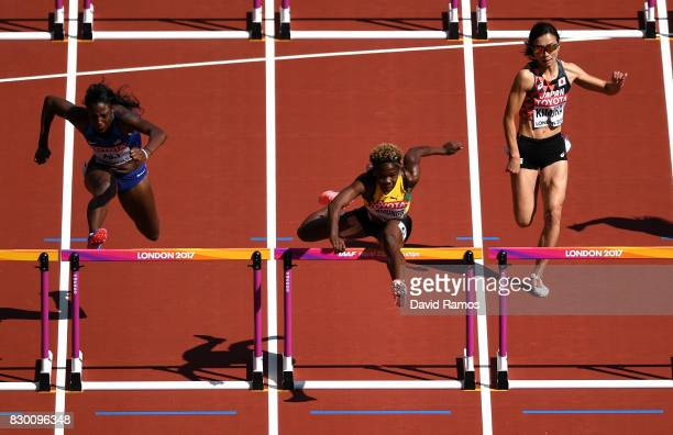 Nia Ali of the United States Megan Simmonds of Jamaica and Ayako Kimura of Japan compete in the Women's 100 metres hurdles heats during day eight of...
