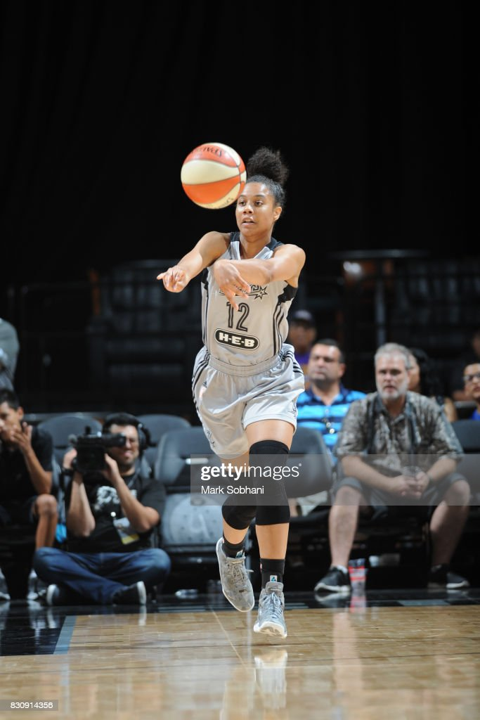 Nia Coffey #12 of the San Antonio Stars passes the ball against the Atlanta Dream on August 12, 2017 at the AT&T Center in San Antonio, Texas.