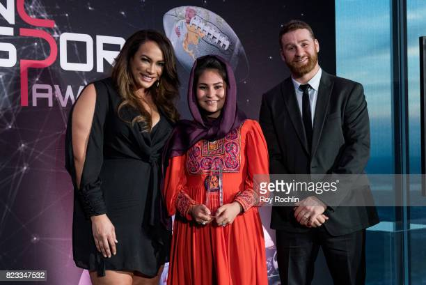 Nia Jax and Sami Zayn present the Courageous Use of Sport award presented by WWE to Hajar Abulfazl during the Beyond Sport Global Awards on July 26...