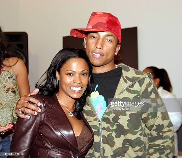 Nia Long and Pharrell Williams during Vote Or Die Political Art Exhibition at Tony Shafrazi Gallery in New York City New York United States