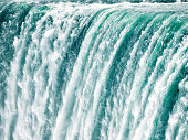 A very fast shutter speed used to freeze the motion of water plunging down the Horseshoe Falls at Niagara.