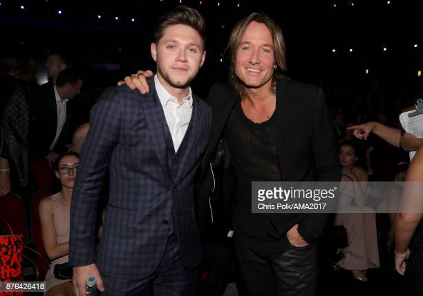 Niall Horan and Keith Urban during the 2017 American Music Awards at Microsoft Theater on November 19 2017 in Los Angeles California